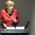 Меркель выступит за привязку санкций к минским соглашениям